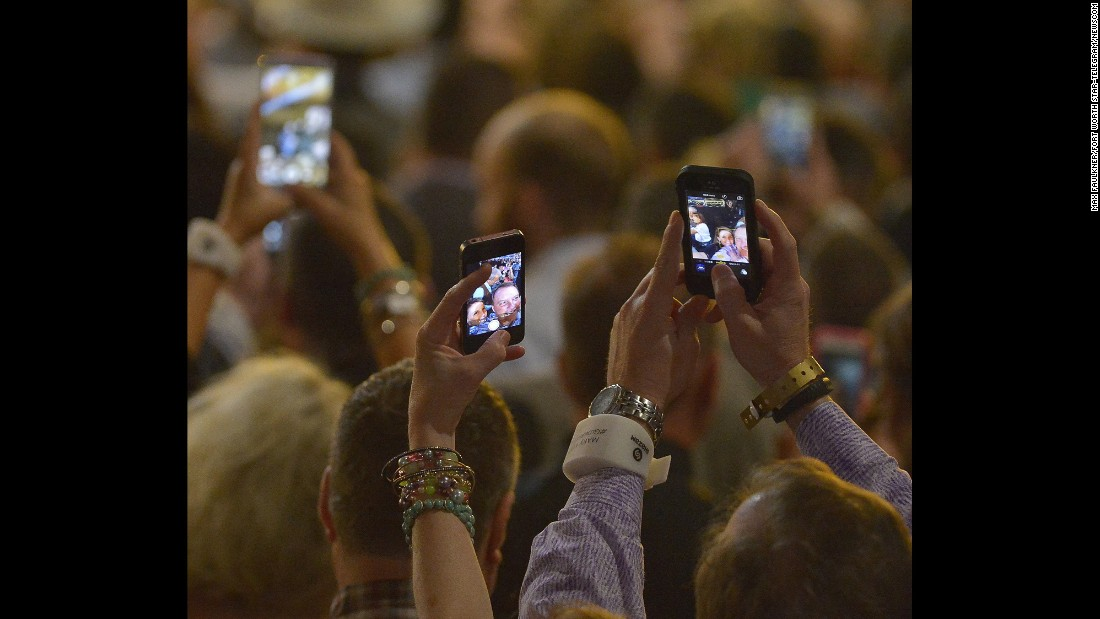 Fans take selfies during the Academy of Country Music Awards, which took place Sunday, April 19, in Arlington, Texas.