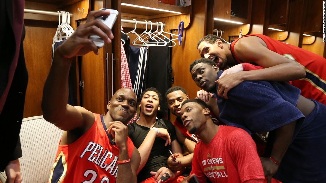 The New Orleans Pelicans celebrate their NBA playoff berth with a locker room selfie on Wednesday, April 15.