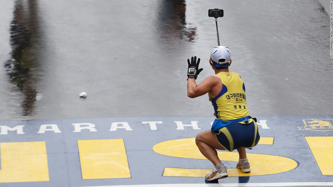 "A runner squats down to take a selfie as he crosses the Boston Marathon finish line on Monday, April 20.<a href=""http://www.cnn.com/2015/04/15/living/gallery/look-at-me-selfies-0415/index.html"" target=""_blank""> See 27 selfies from last week</a>"