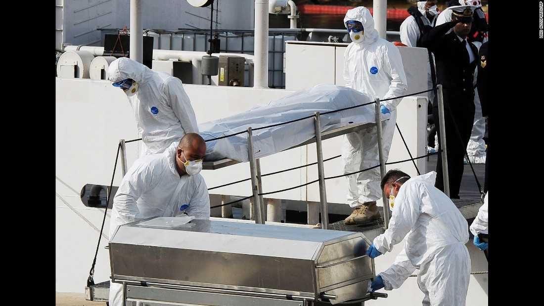 Italian Coast Guard officers carry the body of a dead migrant off a ship in Valletta, Malta, on April 20. A smuggler's boat crammed with hundreds of people overturned off Libya's coast as rescuers approached on Saturday, April 18, causing what could be the Mediterranean Sea's deadliest known migrant tragedy. Hundreds of migrants are believed to have perished as they attempted to cross the Mediterranean from Libya to Italy.