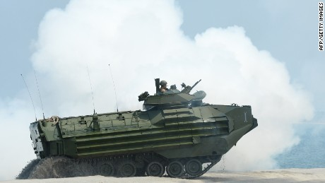 "An amphibious assault vehicle hits the beach during an amphibious landing exercise on a beach at San Antonio in Zambales province on April 21, 2015, as part of annual Philippine-US joint maneuvers some 220 kilometres (137 miles) east of the Scarborough Shoal in the South China Sea. The Philippines voiced alarm April 20 about Chinese ""aggressiveness"" in disputed regional waters as it launched giant war games with the United States that were partly aimed as a warning shot to Beijing. AFP PHOTO/TED ALJIBETED ALJIBE/AFP/Getty Images"