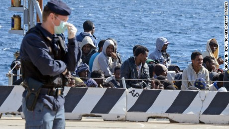A boat transporting migrants arrives in the port of Messina after a rescue operation at see on April 18, 2015 in Sicily.