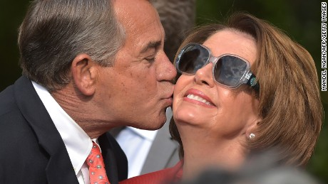 House Speaker John Boehner kisses House Minority Leader Nancy Pelosi during a reception in the Rose Garden of the White House on April 21, 2015.
