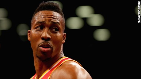 NEW YORK, NY - JANUARY 12:  Dwight Howard #12 of the Houston Rockets looks on before a free throw in the third quarter against the Brooklyn Nets at the Barclays Center on January 12, 2015 in the Brooklyn borough of New York City.The Houston Rockets defeated the Brooklyn Nets 113-99. NOTE TO USER: User expressly acknowledges and agrees that, by downloading and/or using this photograph, user is consenting to the terms and conditions of the Getty Images License Agreement.  (Photo by Elsa/Getty Images)
