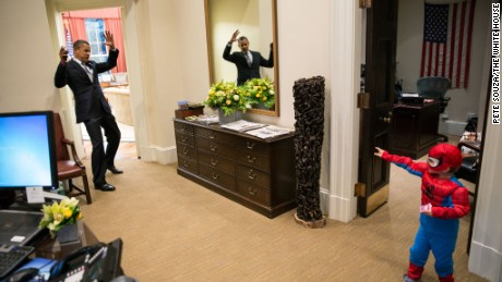 President Obama pretends to be caught in Spider-Man's web as an aide's son goes trick-or-treating.