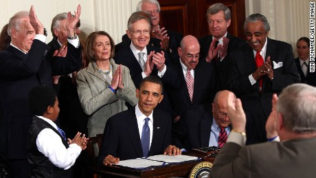 Obama is applauded after signing the Affordable Health Care for America Act during a ceremony with fellow Democrats in the East Room of the White House March 23, 2010 in Washington, DC.