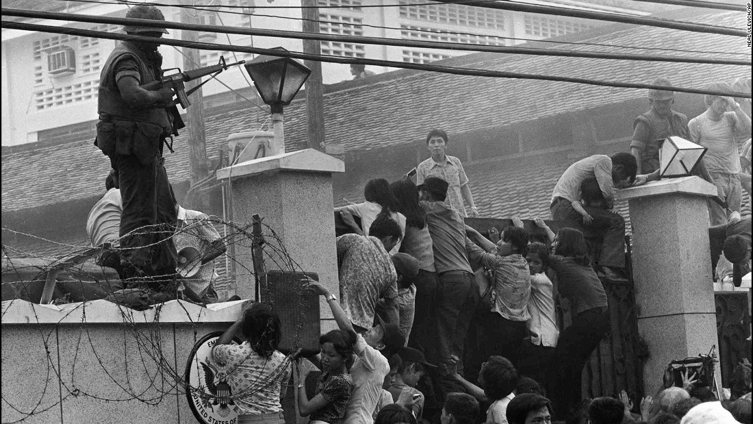 Mobs of Vietnamese people scale the wall of the U.S. Embassy in Saigon on April 29, 1975, trying to get to a helicopter pickup zone. A day later, South Vietnam surrendered to North Vietnam when North Vietnamese troops entered Saigon. Saigon is now called Ho Chi Minh City in honor of the late North Vietnamese leader.