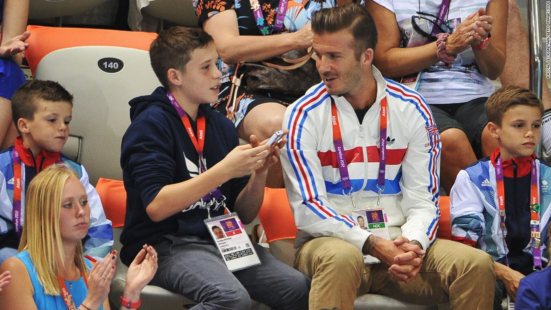 Beckham's children have grown up in the media glare surrounding him -- here he is pictured with sons (L-R) Cruz, Brooklyn and Romeo Beckham during a diving event at the 2012 London Olympics.
