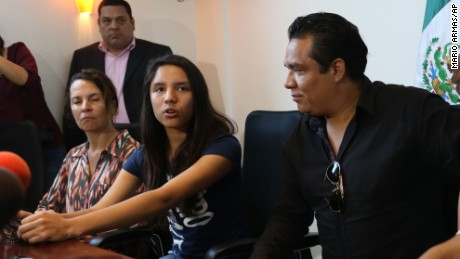 Alondra Luna Nunez, second from left, speaks to the press as she sits with her parents, right, Gustavo Luna and Susana Nunez, after landing at the Guanajuato International Airport in Silao, Mexico, Wednesday, April 22, 2015. The 14-year-old Mexican girl, who was taken from her school by police and sent kicking and screaming to the U.S., returned home after DNA tests showed she is not related to an American woman searching for her missing daughter. There was no immediate explanation of why authorities did not confirm her identity before sending her out of the country. The woman at far left is an unidentified human rights worker.  (AP Photo/Mario Armas)