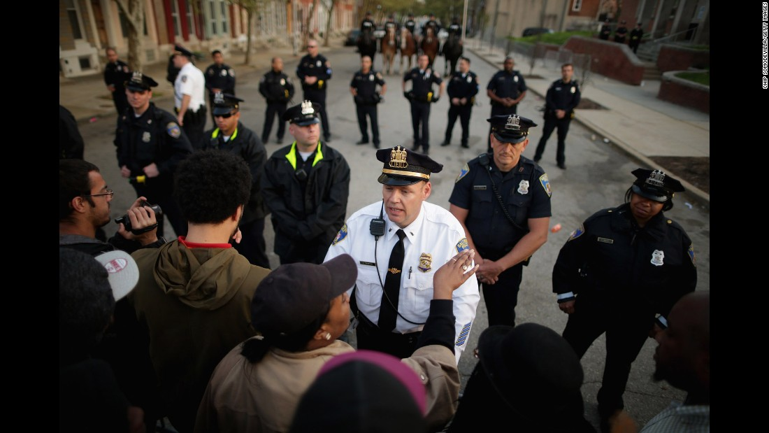 Demonstrators argue with Baltimore officers during the protest on April 22.