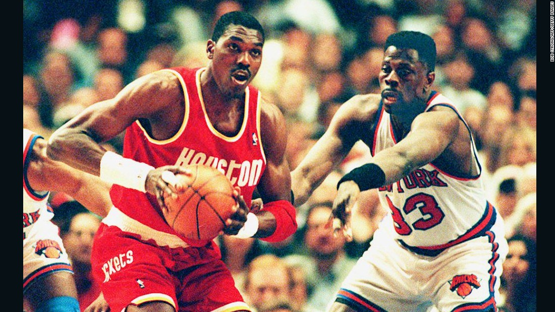 Hakeem Olajuwon joined the Houston Rockets in 1984, and led them to consecutive NBA championships in 1994 and 1995. The Nigerian-born center ended his career at the Toronto Raptors, retiring in 2002.