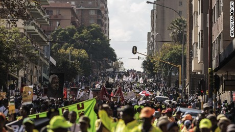 "Thousands march against the recent wave of xenophobic attacks in South Africa through the streets of Johannesburg CBD on April 23, 2015. Several thousand demonstrators marched through central Johannesburg to protest against a spate of deadly attacks on immigrants, after further raids by the authorities on suspected gang hideouts. Watched by police, crowds sang songs denouncing xenophobia and carried banners that read ""We are all Africans"" as migrant workers crowded balconies, shouting their support. AFP PHOTO/GIANLUIGI GUERCIAGIANLUIGI GUERCIA/AFP/Getty Images"