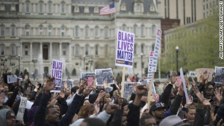 Demonstrators march in protest  of the death of Freddie Gray on April 23.