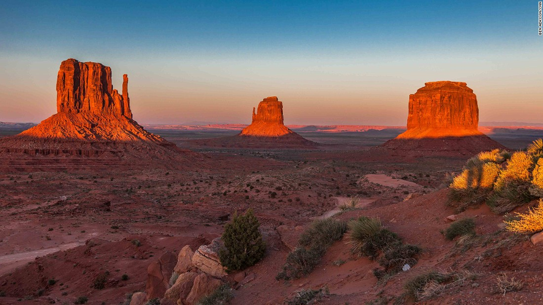 Monument Valley Navajo Tribal Park straddles the Utah/Arizona border and is one of only a few tribal parks in the region. Just inside the park gates you'll get to the visitor center and hotel with this classic view of the famous Mittens Buttes.