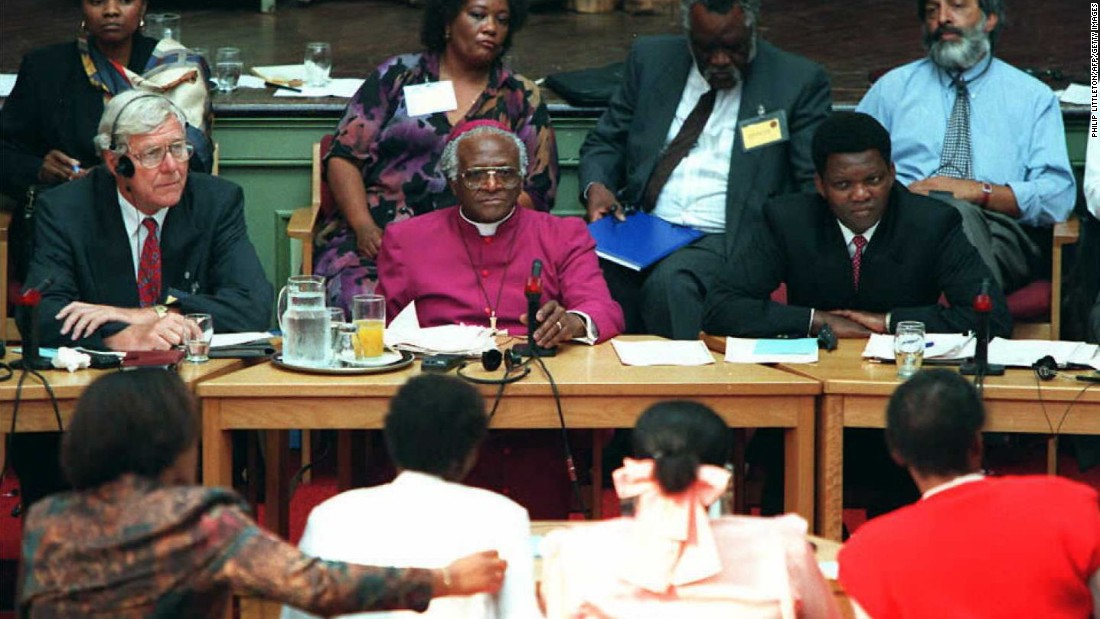 In 1995, Tutu is selected by South African President Nelson Mandela to chair the Truth and Reconciliation Commission. He presents the Commission's final report to South African President Thabo Mbeki in March 2003.