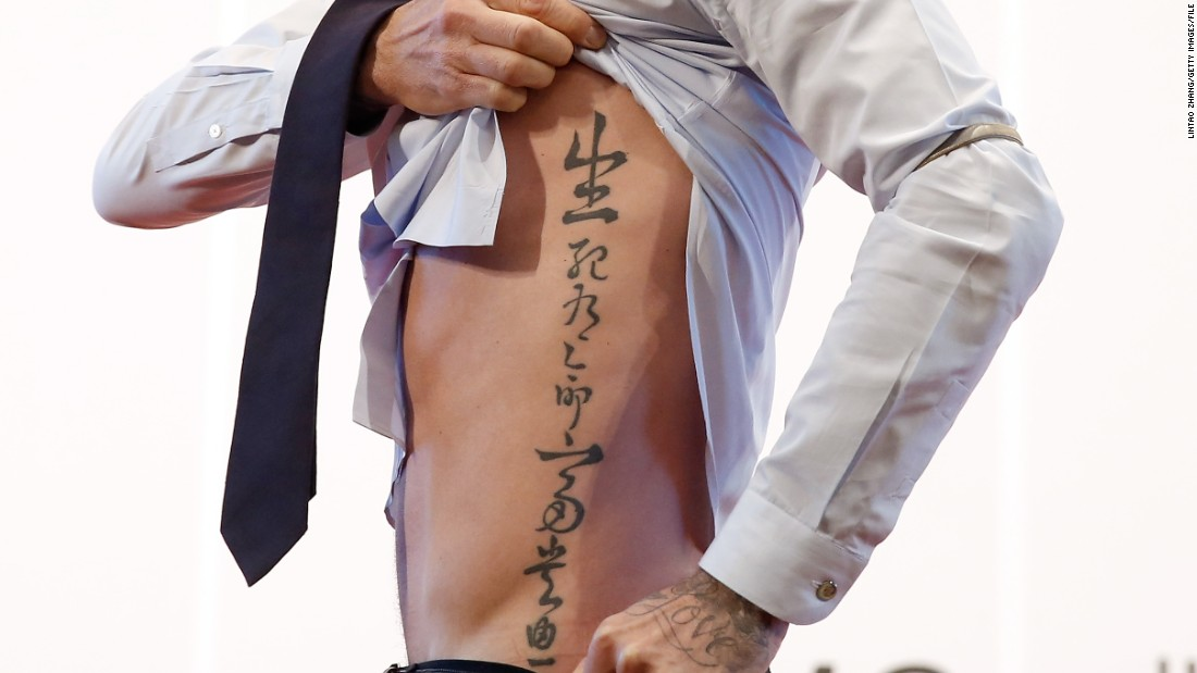 "The previous year, Beckham showed this tattoo to fans in Beijing, having been named an international ambassador by the China Football Association. It reportedly says, ""Death and life have determined appointments. Riches and honor depend upon heaven."""