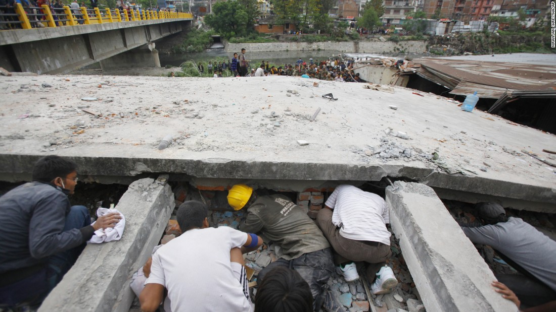 Rescuers look for victims under a collapsed building in Kathmandu on April 25.