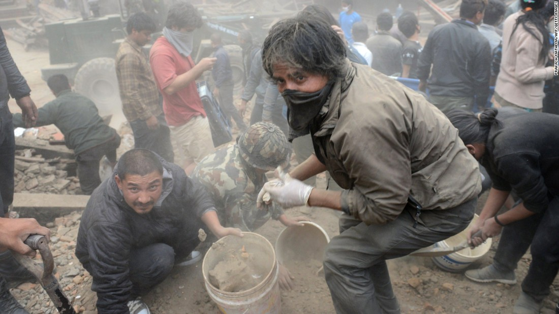 Rescuers clear rubble in Kathmandu's Basantapur Durbar Square on  April 25.