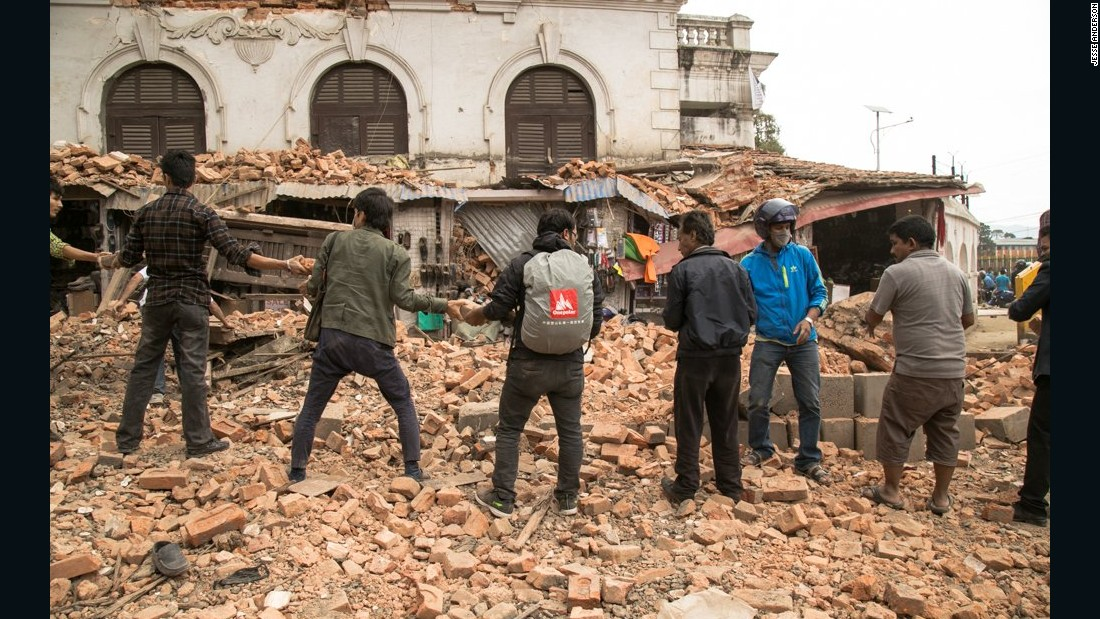 American Jesse Anderson captured residents forming a line to remove debris in searching for survivors about an hour after the earthquake.