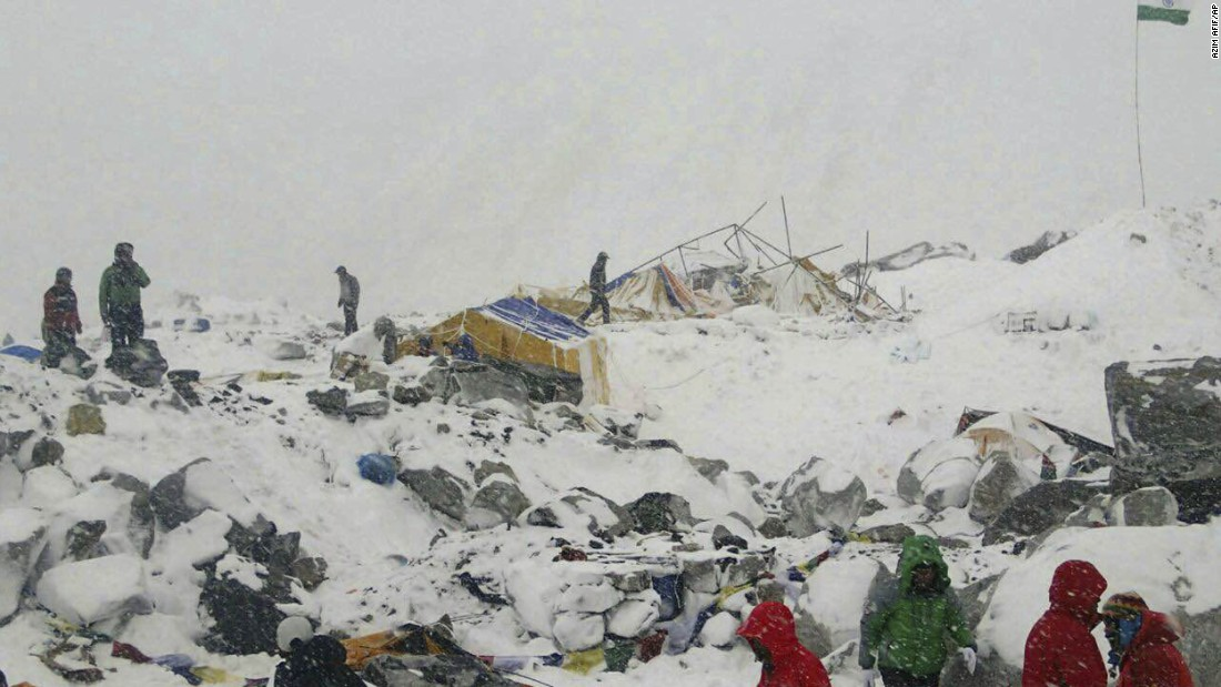 People sort through wreckage near Everest base camp on April 25.