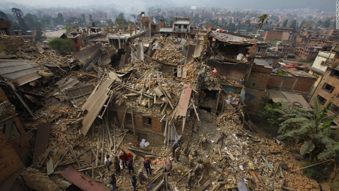 Rescue workers remove debris on April 26 as they search for victims in Bhaktapur.