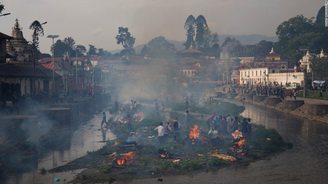 Smoke from funeral pyres fills the air at the Pashupatinath temple on the banks of Bagmati River in Kathmandu on April 26.