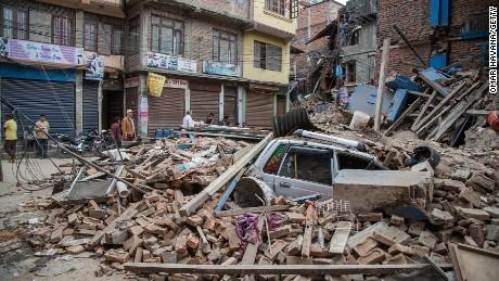 A taxi lies buried in rubble in Thamel, Kathmandu.