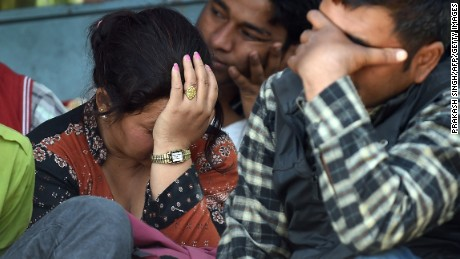 Nepalese residents react as police retrieve the bodies of relatives Chandrawati Mahat, 38, and Prasamsah, 14, during rescue efforts in Balaju in Kathmandu on April 27, 2015. International aid groups and governments intensified efforts to get rescuers and supplies into earthquake-hit Nepal on April 26, 2015, but severed communications and landslides in the Himalayan nation posed formidable challenges to the relief effort. As the death toll surpassed 2,000, the US together with several European and Asian nations sent emergency crews to reinforce those scrambling to find survivors in the devastated capital Kathmandu and in rural areas cut off by blocked roads and patchy phone networks. AFP PHOTO/PRAKASH SINGH        (Photo credit should read PRAKASH SINGH/AFP/Getty Images)