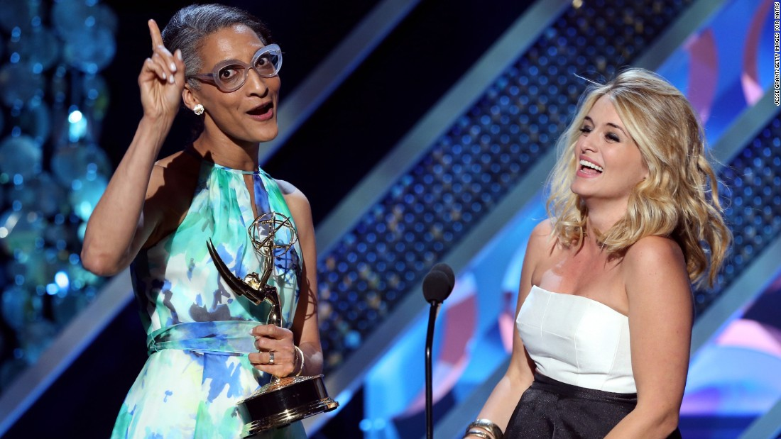 "Carla Hall, left, and Daphne Oz of ""The Chew"" accept the award for outstanding informative talk show host."
