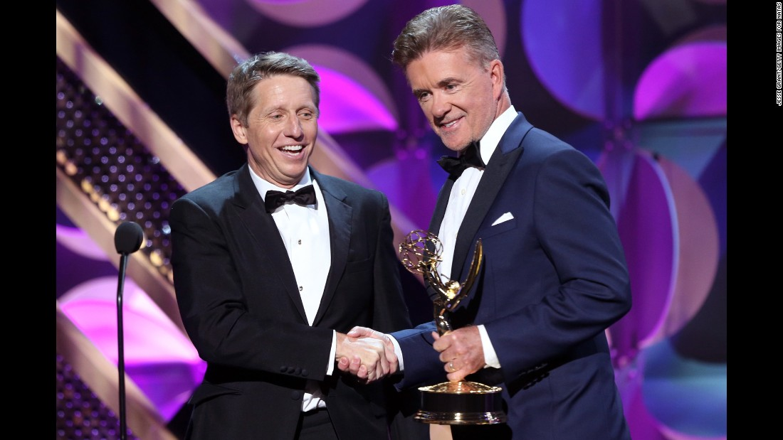 "Actor Alan Thicke, right, presents the award for outstanding drama series writing team to Bradley Bell, head writer and executive producer of ""The Bold and the Beautiful."""