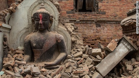BHAKTAPUR, NEPAL - APRIL 26:  A Buddha statue is surrounded by debris from a collapsed temple in the UNESCO world heritage site of Bhaktapur on April 26, 2015 in Bhaktapur, Nepal. A major 7.8 earthquake hit Kathmandu mid-day on Saturday, and was followed by multiple aftershocks that triggered avalanches on Mt. Everest that buried mountain climbers in their base camps. Many houses, buildings and temples in the capital were destroyed during the earthquake, leaving thousands dead or trapped under the debris as emergency rescue workers attempt to clear debris and find survivors.  (Photo by Omar Havana/Getty Images)