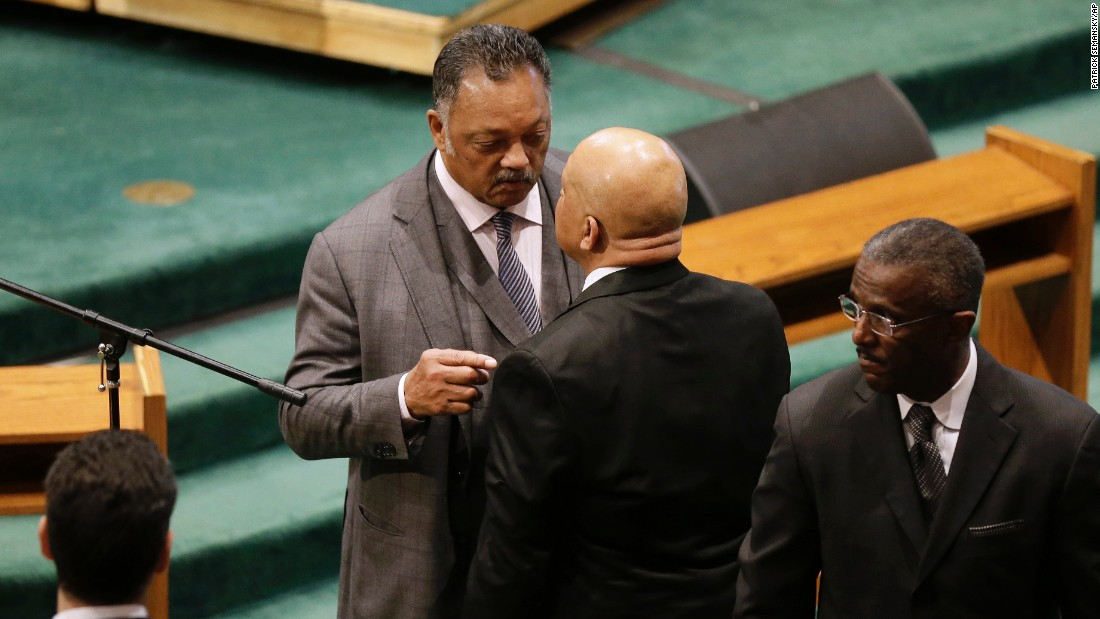 The Rev. Jesse Jackson, left, speaks with Rep. Elijah Cummings of Maryland before the start of the funeral.