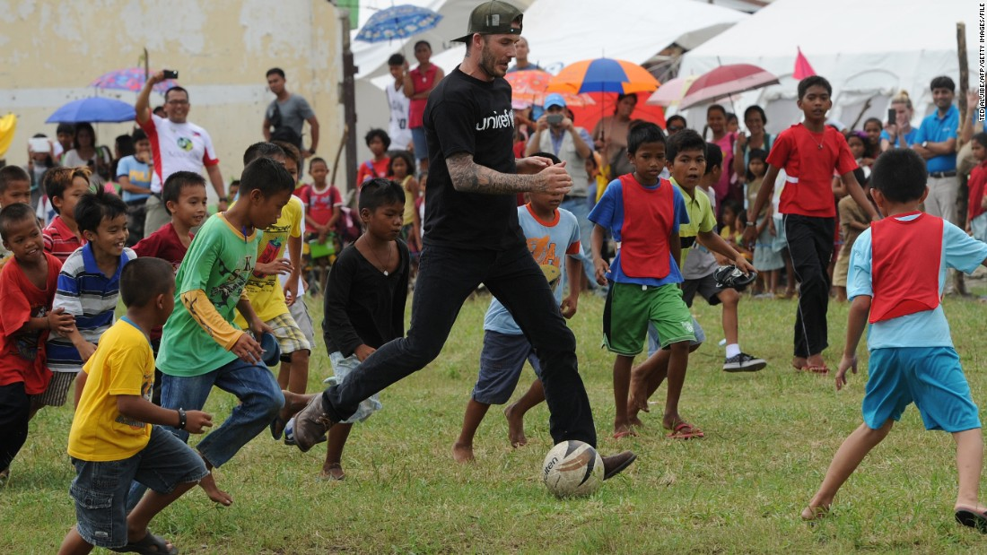 Among his charity projects, Beckham is a UNICEF ambasador. Here he plays with Filipino children who survived Typhoon Haiyan, which killed over 6,000 people in late 2013 and devastated large areas of Southeast Asia.