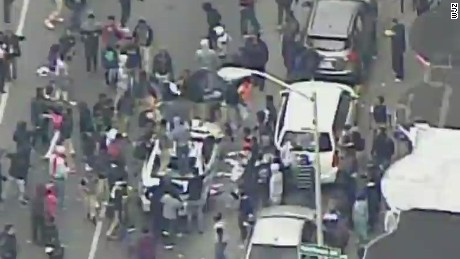 live baltimore protests violent attack police car _00013613.jpg
