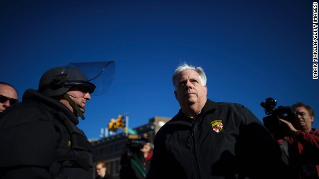 Maryland Gov. Larry Hogan greets Baltimore police dressed in riot gear the morning after citywide riots following the funeral of Freddie Gray, on April 28, 2015, in Baltimore, Maryland.