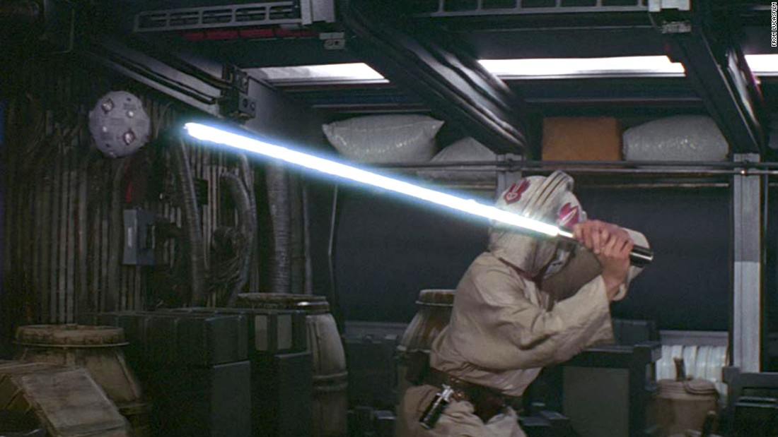 "Luke attempts to master the lightsaber, from the original ""Star Wars."" The young Luke was encouraged to ""use the Force"" to improve his feel with the weapon."