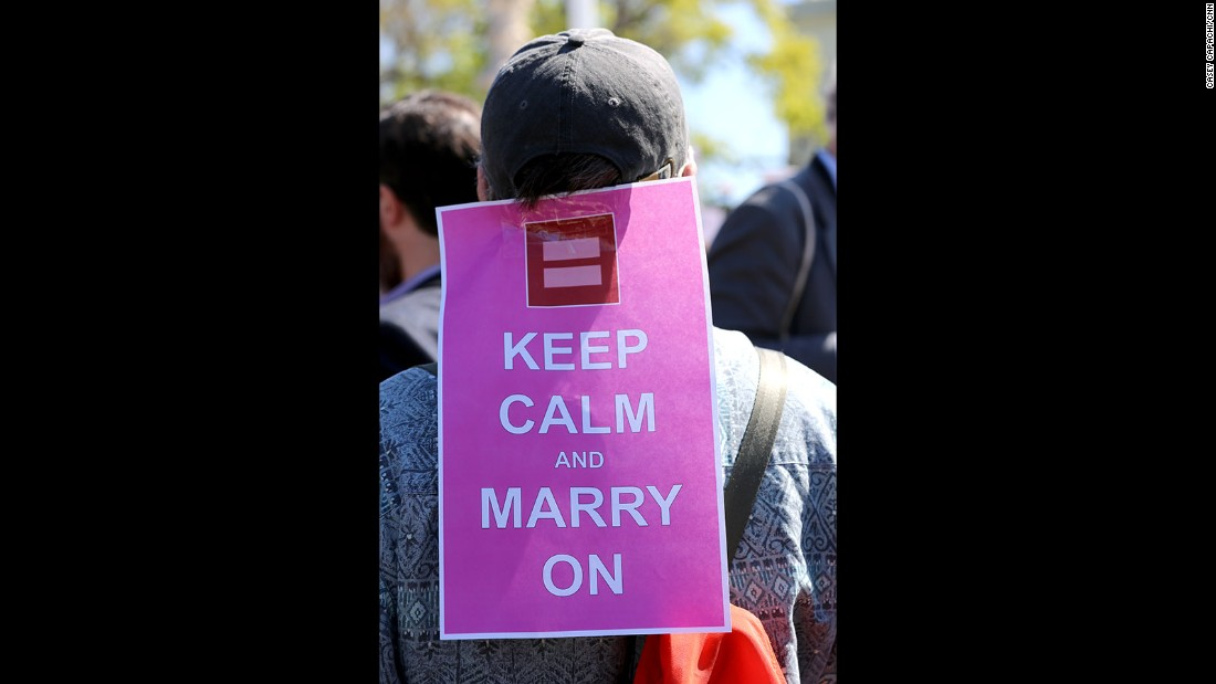 Kevin Rosseel of Washington stands outside the Supreme Court with his sign in support of same-sex marriage.
