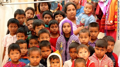 CNN Hero Pushpa Basnet with children in her care, following the earthquake that damaged their home in Kathmandu in 2015.