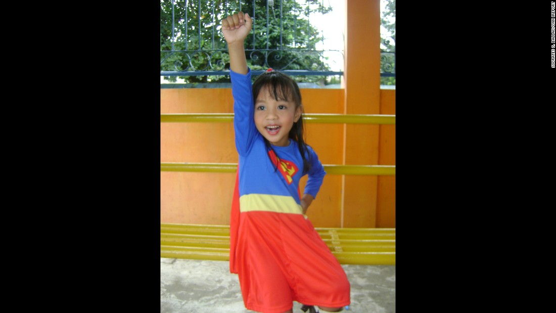 "Four-year-old Anthea Ballais of Tacloban, Philippines, is <a href=""http://ireport.cnn.com/docs/DOC-979832"">seen here</a> imagining herself soaring through the air as Supergirl."