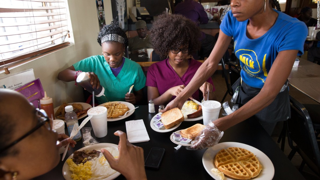 Other patrons enjoy breakfast at MLK Restaurant in Liberty City, a neighborhood in Miami.