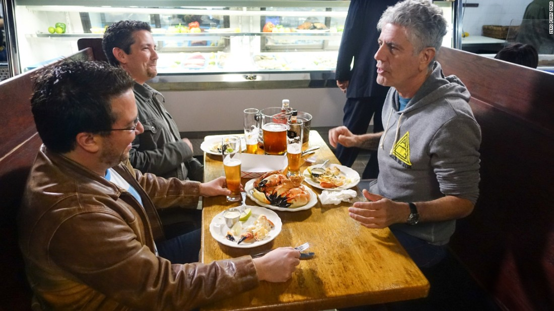 "Bourdain later sits down at at Captain Jim's Seafood Market with Billy Corben and Alfred Spellman, the creators of ""Cocaine Cowboys,"" to understand the once underground economic engine of Miami. During the discussion, they feast on stone crab claws, a South Florida specialty.<br />"