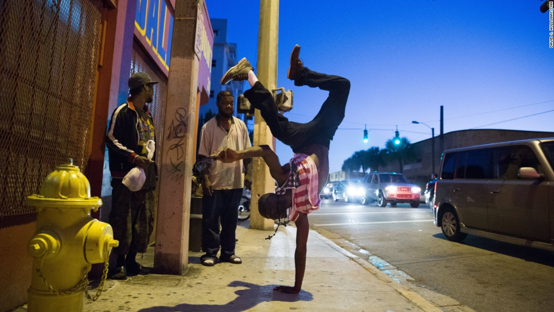 A resident of Miami break dances in the street.