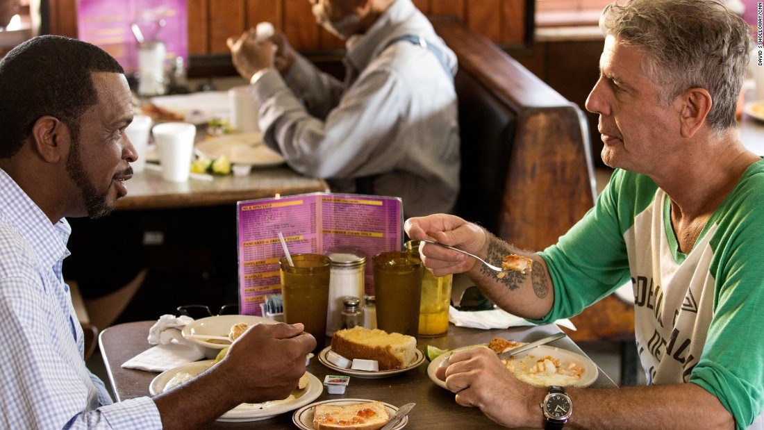"Bourdain enjoys fish and grits at MLK Restaurant with Luther Campbell, who is credited with pioneering the type of music that  would later be called ""Miami bass."""