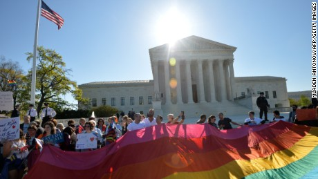 Supporters of same-sex marriages gather outside the U.S. Supreme Court waiting for its decision on April 28, 2014 in Washington, D.C.