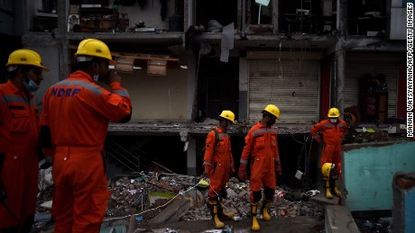 India's National Disaster Response Force (NDRF) personnel search for earthquake survivors as they clear rubble from a destroyed building in Kathmandu on April 28, 2015.