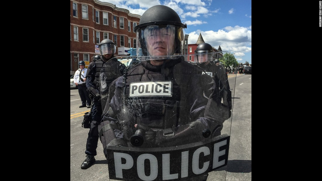 "In all, there were ""27 officers standing shoulder to shoulder in full riot gear,"" Larson says."