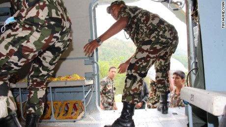 Nepalese soldiers offload packs of rice, noodles and tuna, medicine and tents in Melamchi.