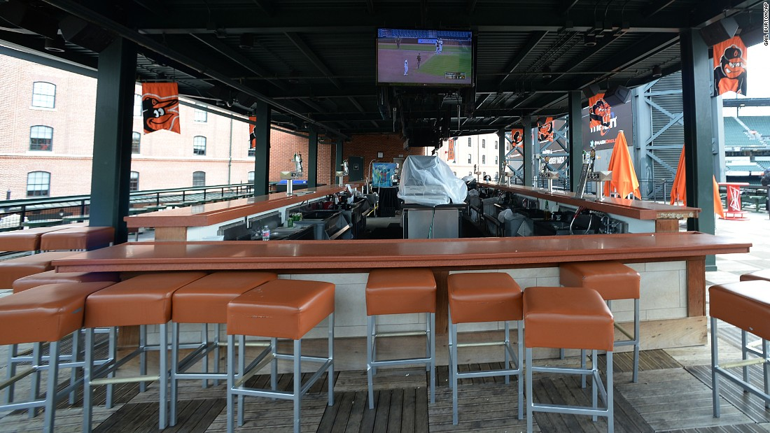 A bar showing the baseball game sits empty behind center field.