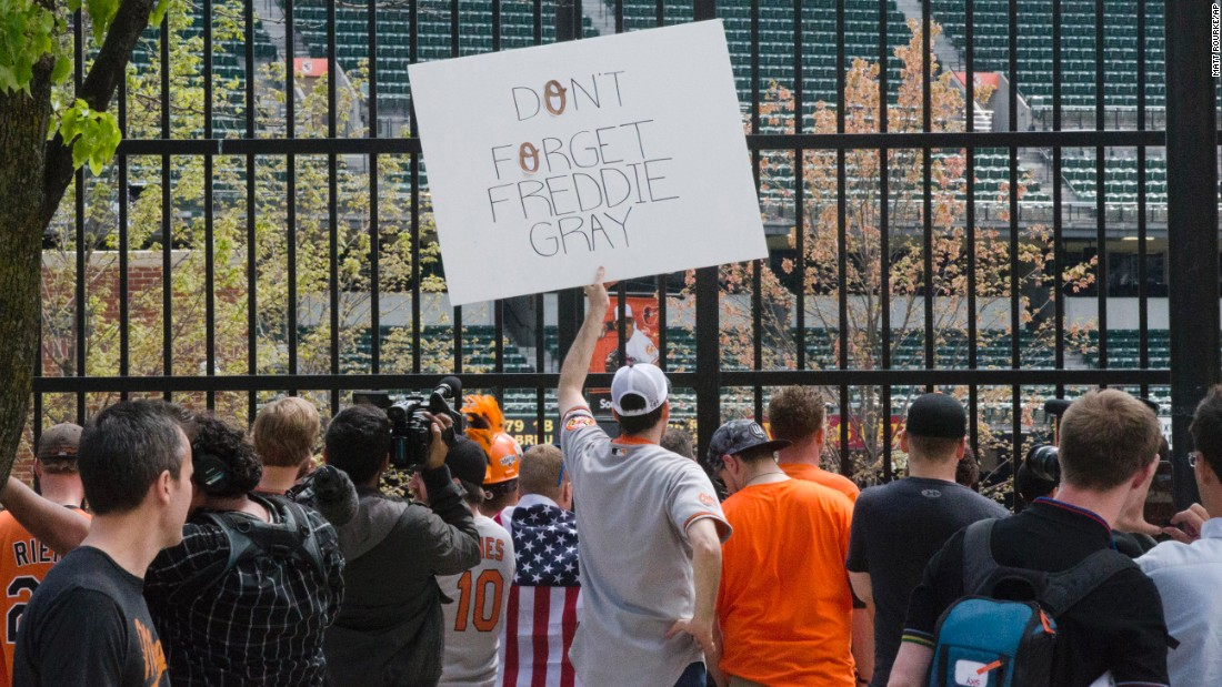 Fans view the game from outside Oriole Park.