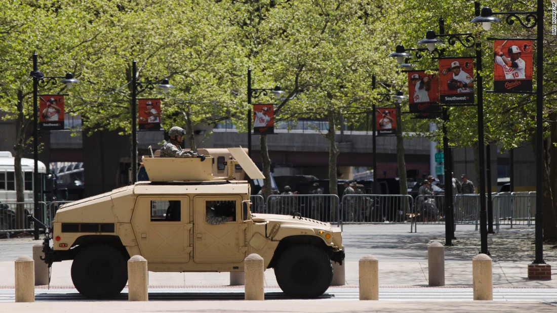 A National Guard vehicle passes Oriole Park.